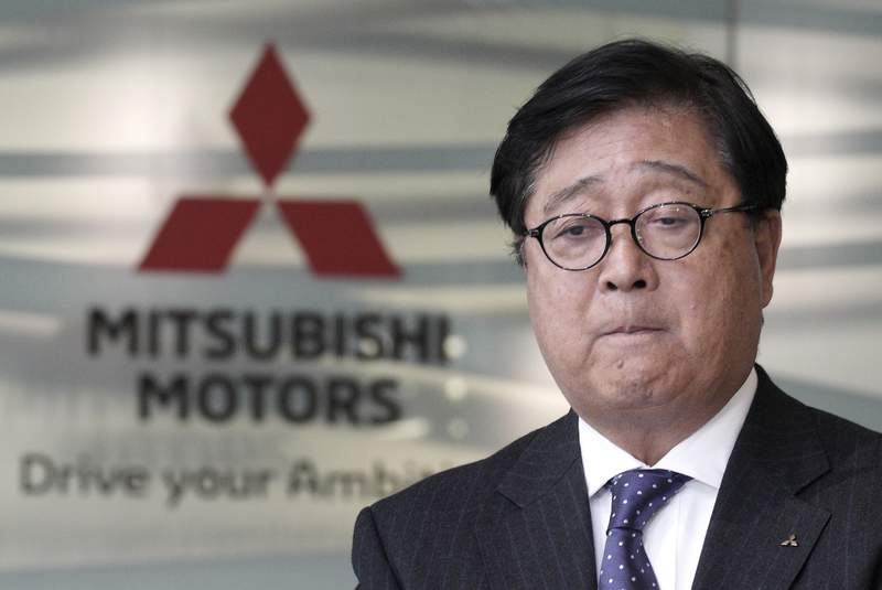 FILE - In this Jan. 18, 2019, file photo, Mitsubishi Motors CEO Osamu Masuko bites his lips during a press conference at its headquarters in Tokyo. Mitsubishi Motors Corp. Special Adviser Osamu Masuko, who engineered the alliance with Nissan, has died, the Japanese automaker said Monday, Aug. 31, 2020. He was 71. (AP Photo/Eugene Hoshiko, File)