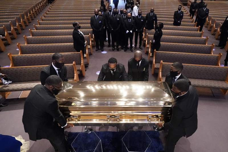 The casket of George Floyd is placed in the chapel during a funeral service for Floyd at the Fountain of Praise church, Tuesday, June 9, 2020, in Houston. (AP Photo/David J. Phillip, Pool)