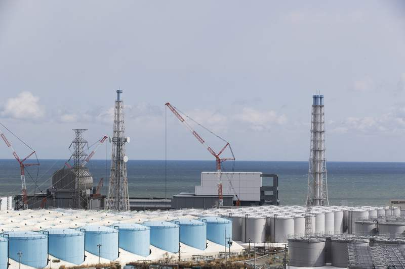 FILE - In this Feb. 27, 2021, file photo, the Pacific Ocean looks over nuclear reactor units of No. 3, left, and 4 at the Fukushima Daiichi nuclear power plant in Okuma town, Fukushima prefecture, northeastern Japan. The Japanese government has decided to get rid of the massive amounts of treated but still radioactive water stored in tanks at the wrecked Fukushima nuclear plant by releasing it into the Pacific ocean, a conclusion widely expected but delayed for years amid protests and safety concerns. Prime Minister Yoshihide Suga on Wednesday, April 7, 2021, told top fisheries association officials that his government believes the release to sea is the most realistic option and a final decision will be made with days.(AP Photo/Hiro Komae, File)