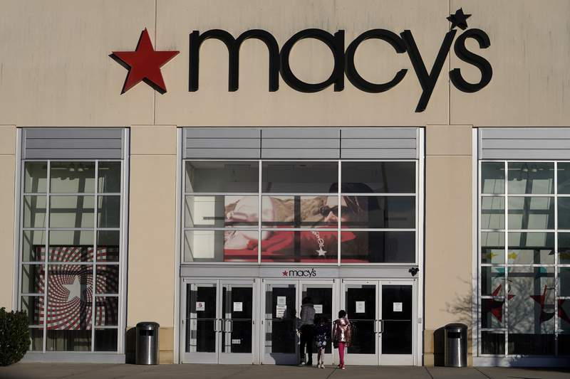 FILE - In this Feb. 22, 2021 file photo, shoppers arrive at a Macy's in Charlotte, N.C. Macys emerged from an unprecedented year by swinging to a profit and it upped its expectations for the year. The retailer on Tuesday, May 18, 2021, posted net income of $103 million, after reporting a loss in the same period a year earlier. (AP Photo/Chris Carlson, File)