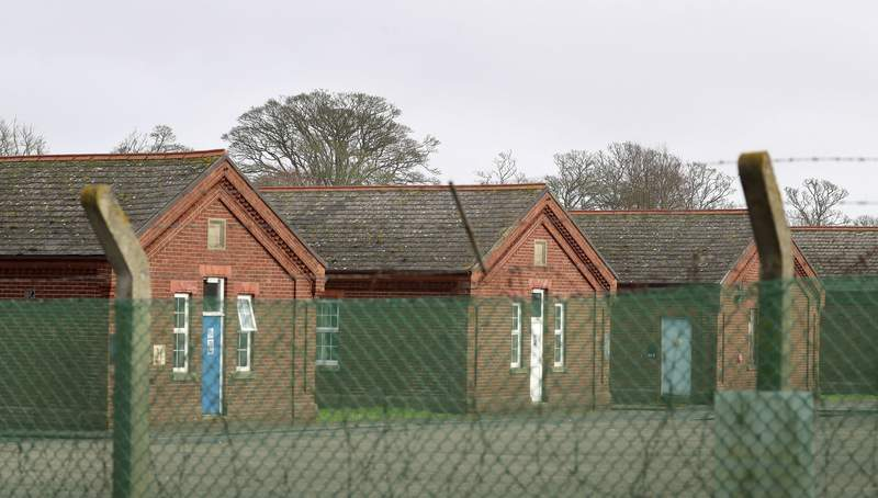FILE - In this file photo dated Jan. 19, 2021, Napier Barracks in Folkestone, England, which was used by the government to house people seeking asylum in the UK.  Britains High Court ruled Thursday June 3, 2021, that the government broke the law when it housed asylum-seekers in overcrowded, run-down conditions in a disused army barracks.(Gareth Fuller/PA FILE via AP)