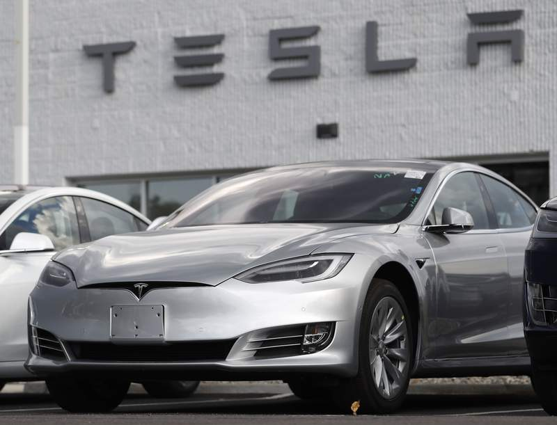 FILE - This July 8, 2018 photo shows a Tesla 2018 Model 3 sedans sitting on display outside a Tesla showroom in Littleton, Colo. The driver of a Tesla Model 3 involved in a fatal crash that California highway authorities said may have been on operating on Autopilot posted social media videos of himself riding in the vehicle without his hands on the wheel or foot on the pedal. The May 5, 2021, crash in Fontana, a city 50 miles (80 kilometers) east of Los Angeles, is also under investigation by the National Highway Traffic Safety Administration. The probe is the 29th case involving a Tesla that the federal agency has probed. (AP Photo/David Zalubowsi, File)