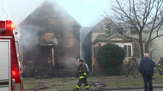 Two homes were damaged in fires on 30th Street in Detroit on Wednesday, April 11, 2018. (WDIV)