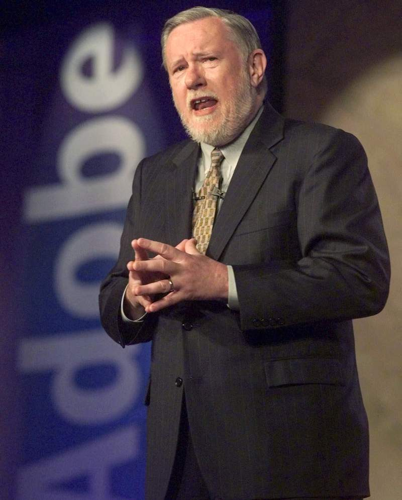 "FILE - In this June 24, 1999, file photo, Dr. Charles M. Geschke, president, co-chairman and co-founder of Adobe Systems Inc., delivers his keynote address about the future of workplace information on the final day of PC Expo at New York's Jacob K. Javits Convention Center. Charles ""Chuck"" Geschke, the co-founder of the major software company Adobe Inc., who helped develop Portable Document Format technology, or PDFs, died at age 81. Geschke, who lived in the San Francisco Bay Area suburb of Los Altos, died Friday, April 16, 2021, the company said. (AP Photo/Richard Drew, File)"