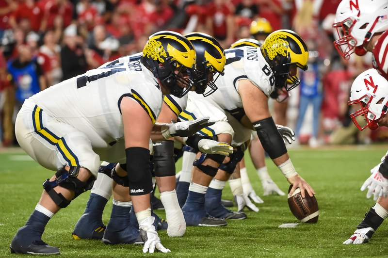 Offensive lineman Andrew Vastardis #68 of the Michigan Wolverines prepares to snap the ball against the Nebraska Cornhuskers in the first half at Memorial Stadium on October 9, 2021 in Lincoln, Nebraska.