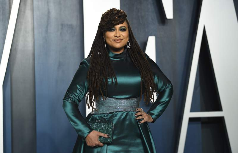 """FILE -This Feb. 9, 2020 file photo shows filmmaker Ava DuVernay at the Vanity Fair Oscar Party in Beverly Hills, Calif. DuVernay directed the four-part Netflix series """"When They See US,"""" which explores the true story of the Central Park Five, five black and Latino teenagers who were coerced into confessing to a rape they didn't commit in 1989. (Photo by Evan Agostini/Invision/AP, File)"""