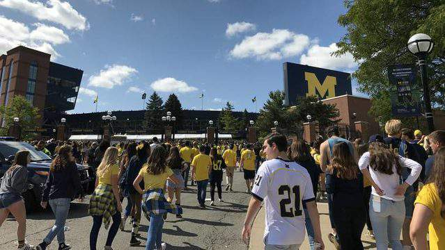 Students and fans walk to Michigan Stadium for the first home football game of the season on Sept. 9, 2017. (Credit: Meredith Bruckner)