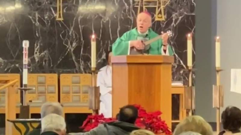 Priest plays ukulele, sings during mass at Catholic church in Livonia
