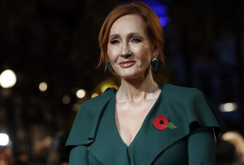 """FILE - Author J.K. Rowling appears at the world premiere of the film """"Fantastic Beasts: The Crimes of Grindelwald"""" in Paris on Nov. 8, 2018.  Scholastic announced Tuesday that Rowling's The Christmas Pig, the story of a boy named Jack and a beloved toy (Dur Pig) which goes missing, will be released worldwide Oct. 12. (AP Photo/Christophe Ena, File)"""