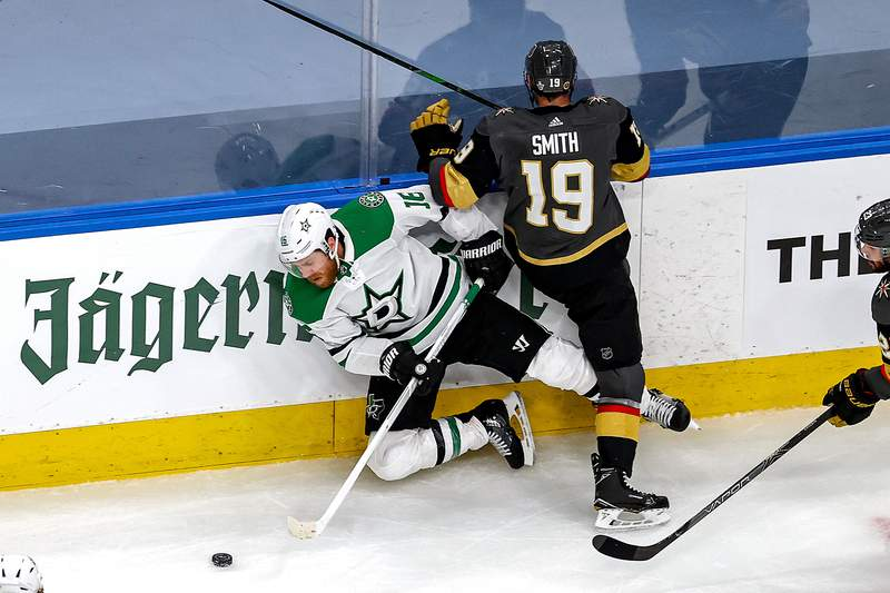 EDMONTON, ALBERTA - SEPTEMBER 06:  Reilly Smith #19 of the Vegas Golden Knights checks Joe Pavelski #16 of the Dallas Stars during the third period in Game One of the Western Conference Final during the 2020 NHL Stanley Cup Playoffs at Rogers Place on September 06, 2020 in Edmonton, Alberta, Canada. (Photo by Bruce Bennett/Getty Images)