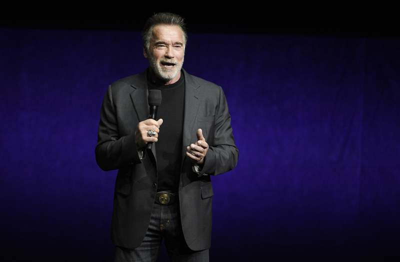 """FILE - Arnold Schwarzenegger discusses """"Terminator: Dark Fate"""" during the Paramount Pictures presentation at CinemaCon on April 4, 2019, in Las Vegas. Schwarzenegger says he feels """"fantastic"""" after his recent heart surgery. The 73-year-old actor and former California governor said on social media Friday, Oct. 23, 2020, that he had a new aortic valve implanted in his heart. (Photo by Chris Pizzello/Invision/AP, File)"""