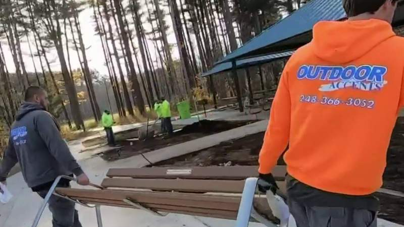 Volunteers beautiful Scarlet's Playground in Commerce Township
