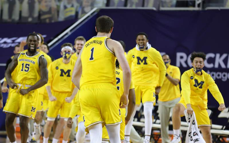 Hunter Dickinson #1 of the Michigan Wolverines celebrates during a second-half timeout during the game against the Wisconsin Badgers at Crisler Arena on January 12, 2021 in Ann Arbor, Michigan.