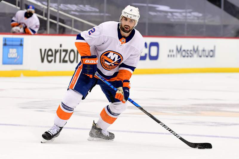 PITTSBURGH, PENNSYLVANIA - MAY 18: Nick Leddy #2 of the New York Islanders handles the puck against the Pittsburgh Penguins during the third period in Game Two of the First Round of the 2021 Stanley Cup Playoffs at PPG PAINTS Arena on May 18, 2021 in Pittsburgh, Pennsylvania. The Pittsburgh Penguins won 2-1. (Photo by Emilee Chinn/Getty Images)
