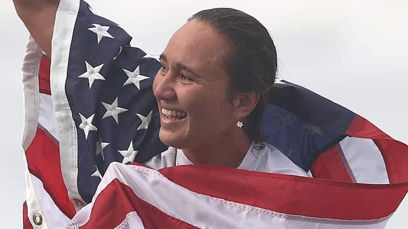 Carissa Moore celebrates winning the gold medal in surfing.