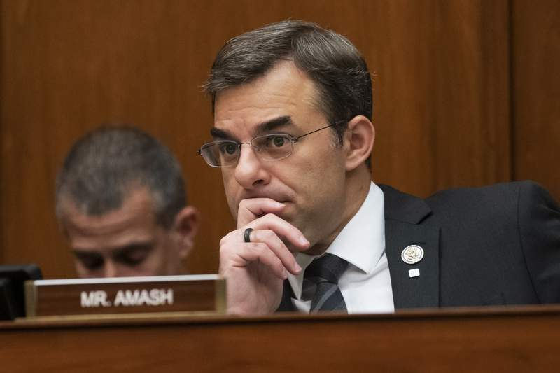 FILE - In this June 12, 2019, file photo, Rep. Justin Amash, R-Mich., listens to debate on Capitol Hill in Washington. The first major third-party candidate is emerging in the contest between President Donald Trump and presumptive Democratic nominee Joe Biden. Amash wants to seek the White House as a Libertarian after switching from Republican to independent last July 4 and voting in favor of Trumps impeachment. (AP Photo/J. Scott Applewhite, File)
