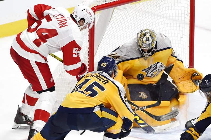Nashville Predators goaltender Juuse Saros (74) blocks a shot by Detroit Red Wings right wing Bobby Ryan (54) during the third period of an NHL hockey game Tuesday, March 23, 2021, in Nashville, Tenn. The Predators won 2-0. (AP Photo/Mark Zaleski)