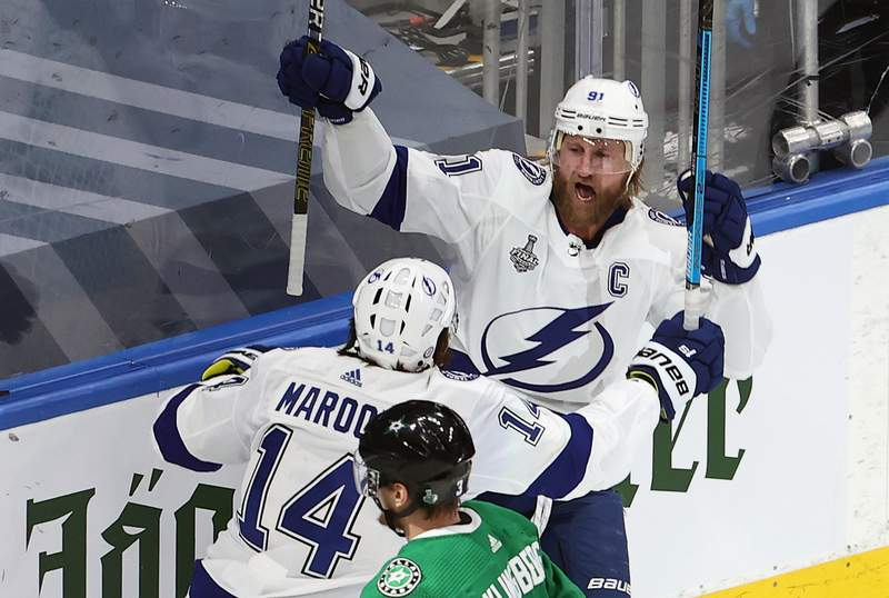 EDMONTON, ALBERTA - SEPTEMBER 23: Steven Stamkos #91 of the Tampa Bay Lightning is congratulated by Pat Maroon #14 after scoring a goal against the Dallas Stars during the first period in Game Three of the 2020 NHL Stanley Cup Final at Rogers Place on September 23, 2020 in Edmonton, Alberta, Canada. (Photo by Bruce Bennett/Getty Images)