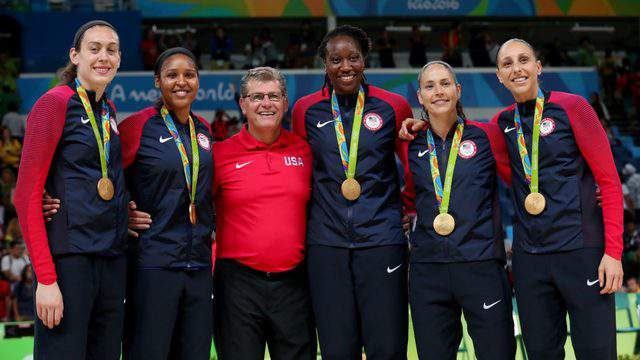 RIO DE JANEIRO, BRAZIL - AUGUST 20: (L-R) Gold medalists Breanna Stewart #9, Maya Moore #7, head coach Geno Auriemma, Tina Charles #14, Sue Bird #6 and Diana Taurasi #12 of United States pose for photos after the Women's Basketball competition on Day 15 of the Rio 2016 Olympic Games at Carioca Arena 1 on August 20, 2016 in Rio de Janeiro, Brazil. (Photo by Tom Pennington/Getty Images)