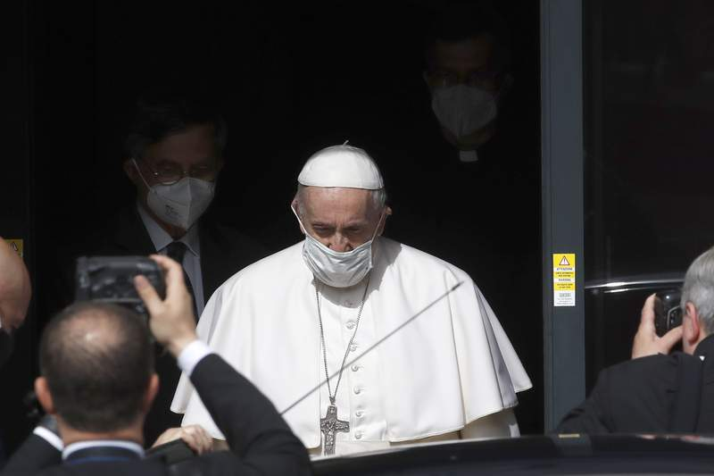 Pope Francis leaves after a visit to Radio Vaticana offices in Rome Monday, May 24, 2021. (AP Photo/Alessandra Tarantino)
