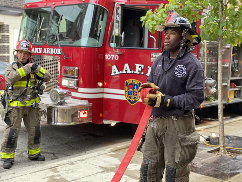 A firefighter rolls a hose as part of AAFD training on Sept. 30, 2020.