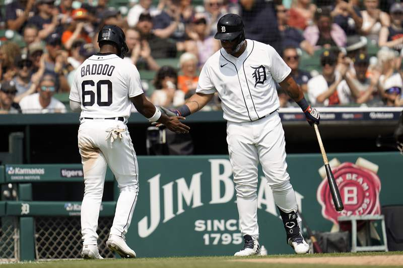 Detroit Tigers' Akil Baddoo (60) celebrates scoring with Miguel Cabrera on a Jonathan Schoop single in the sixth inning of a baseball game against the Boston Red Sox in Detroit, Thursday, Aug. 5, 2021.