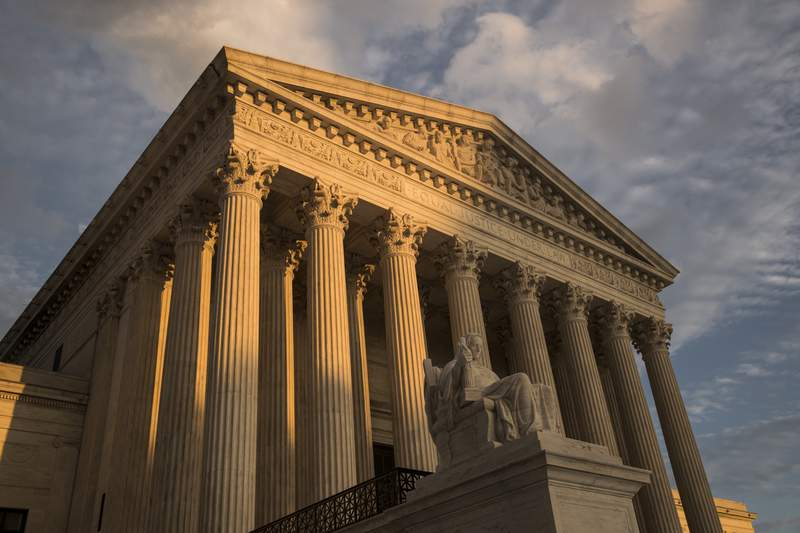 FILE - In this Oct. 10, 2017, file photo, the Supreme Court in Washington, at sunset. A Supreme Court that seems more favorable to religion-based discrimination claims is set to hear a case that could make it easier to use public money to pay for religious schooling in many states. (AP Photo/J. Scott Applewhite, File)