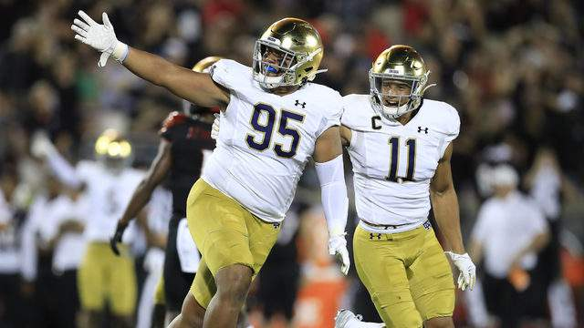 Myron Tagovailoa-Amosa #95 and Alohi Gilman #11 of the Notre Dame Fighting Irish celebrate after the Irish recovered a fumble against the Louisville Cardinals on September 02, 2019 in Louisville, Kentucky. (Photo by Andy Lyons/Getty Images)