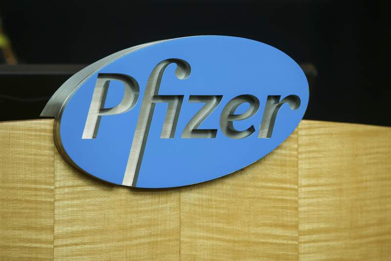 FILE - In this file photo dated Wednesday, July 22, 2020, a Pfizer sign is seen on a podium at the Pfizer Research & Development Laboratories, in Groton, USA.  The U.K. health authorities rolled out a national mass vaccination program Tuesday Dec. 8, 2020, using the Pfizer-BioNTech COVID-19 vaccine.  U.K. regulators said Wednesday Dec. 9, 2020, that people who have a significant history of allergic reactions shouldnt receive the new Pfizer/BioNTech vaccine while they investigate two adverse reactions that occurred on the first day of the countrys mass vaccination program. (AP Photo/Stew Milne)