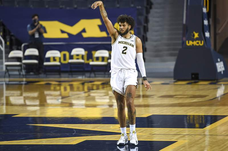 ANN ARBOR, MICHIGAN - NOVEMBER 29: Isaiah Livers #2 of the Michigan Wolverines reacts after scoring a three pointer against the Oakland Golden Grizzlies during overtime at Crisler Arena on November 29, 2020 in Ann Arbor, Michigan. (Photo by Nic Antaya/Getty Images)