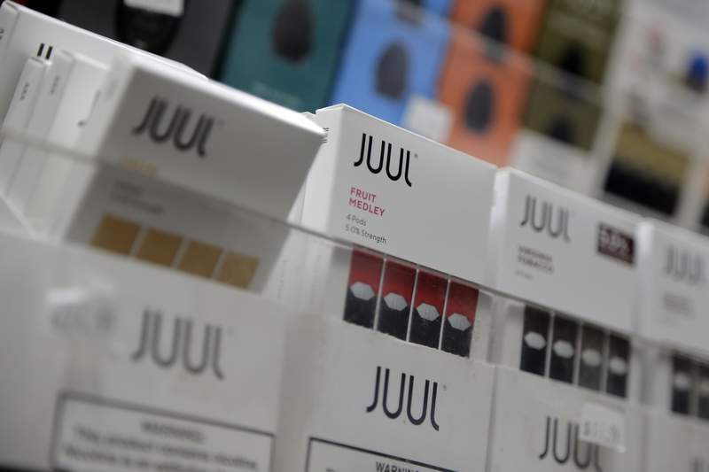 FILE - In this Dec. 20, 2018, file photo Juul products are displayed at a smoke shop in New York. (AP Photo/Seth Wenig, File)