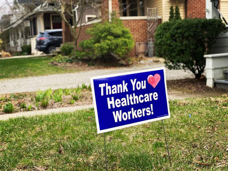 """A sign that reads """"Thank You Healthcare Workers!"""" sits in the front yard of a home in Ann Arbor on April 7, 2020."""