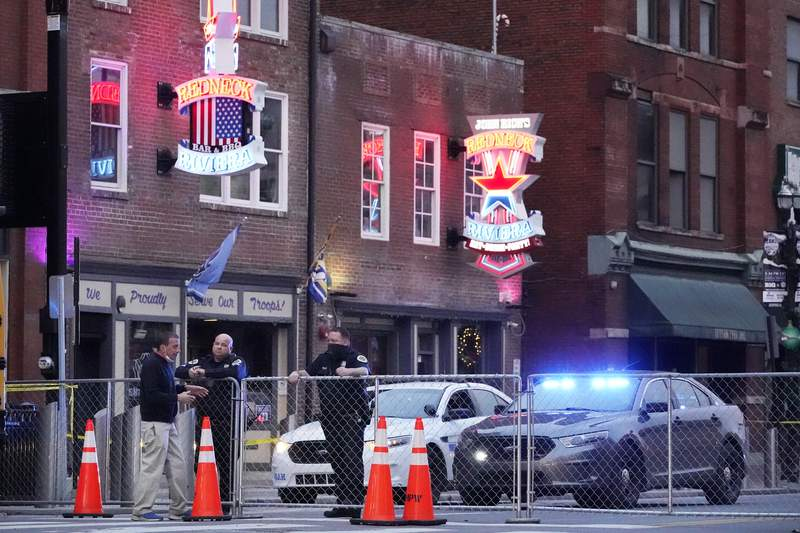 FILE - In this Dec. 28, 2020 file photo, police block off a part of the Broadway tourist district as a result of a bombing that took place on Christmas Day in Nashville, Tenn. (AP Photo/Mark Humphrey)