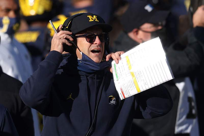 Head coach Jim Harbaugh of the Michigan Wolverines reacts in the second half while playing the Penn State Nittany Lions at Michigan Stadium on November 28, 2020 in Ann Arbor, Michigan.
