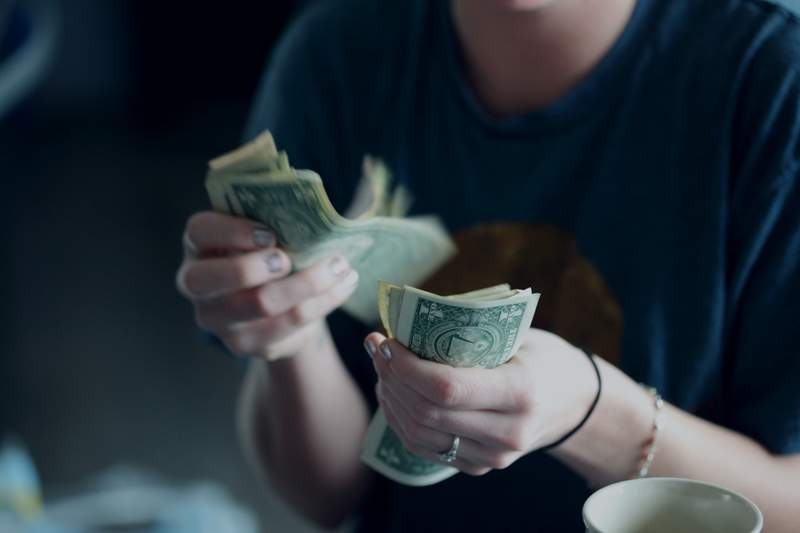 Woman holds cash