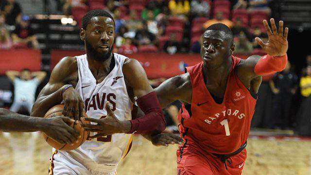 LAS VEGAS, NV - JULY 15: Scoochie Smith #12 of the Cleveland Cavaliers drives against Rawle Alkins #1 of the Toronto Raptors during a quarterfinal game of the 2018 NBA Summer League at the Thomas & Mack Center on July 15, 2018 in Las Vegas, Nevada. The Cavaliers defeated the Raptors 82-68. (Photo by Ethan Miller/Getty Images)