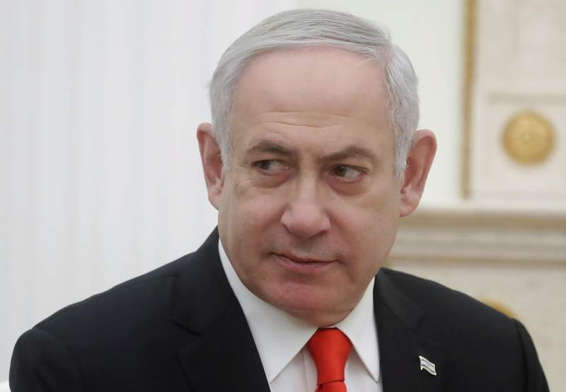 Israeli Prime Minister Benjamin Netanyahu listens to Russian President Vladimir Putin during their meeting in the Kremlin in Moscow, Russia, Thursday, Jan. 30, 2020. Netanyahu visited Moscow to discuss the U.S. Mideast peace plan with Putin and take an Israeli woman who had been jailed in Russia back home. (Maxim Shemetov/Pool Photo via AP)