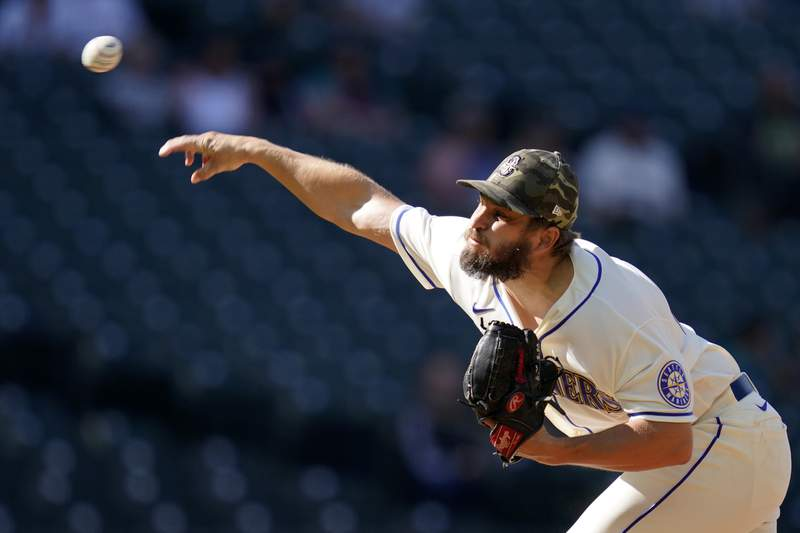 Seattle Mariners relief pitcher Kendall Graveman throws against the Cleveland Indians in the ninth inning of a baseball game Sunday, May 16, 2021, in Seattle. (AP Photo/Elaine Thompson)