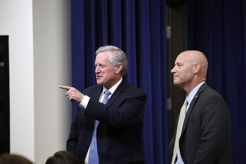 White House chief of staff Mark Meadows, left, and Vice President Mike Pence's chief of staff Marc Short speak before an event with President Donald Trump to sign executive orders on lowering drug prices, in the South Court Auditorium in the White House complex, Friday, July 24, 2020, in Washington. (AP Photo/Alex Brandon)