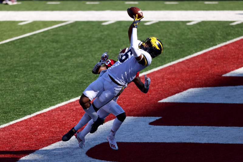 Cornelius Johnson #6 of the Michigan Wolverines catches a touchdown pass during the first quarter against the Indiana Hoosiers at Memorial Stadium on November 07, 2020 in Bloomington, Indiana.