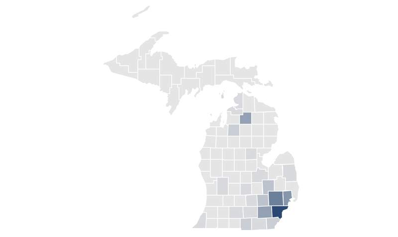 The map shows confirmed COVID-19 cases and COVID-19-related deaths per 100,000 residents in Michigan counties (March 30, 2020)