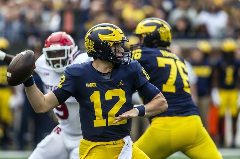 Michigan quarterback Cade McNamara (12) throws a pass in the second quarter of an NCAA college football game against Rutgers in Ann Arbor, Mich., Saturday, Sept. 25, 2021.