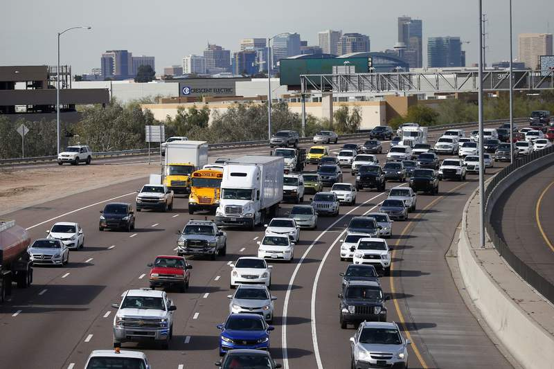 FILE - In this Jan. 24, 2020 file photo, early rush hour traffic rolls along I-10 in Phoenix. The U.S. governments road safety agency is offering a smartphone app that will alert drivers if their vehicles are recalled. The National Highway Traffic Safety Administration was to roll out the app for Android and Apple phones on Thursday, Aug. 27. (AP Photo/Ross D. Franklin, File)