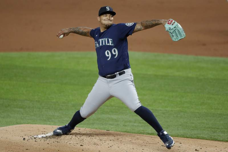 FILE - Seattle Mariners starting pitcher Taijuan Walker (99) throws to the Texas Rangers in the first inning of a baseball game in Arlington, Texas, in this Wednesday, Aug. 12, 2020, file photo. The Mets made a late addition to their starting rotation, agreeing to a $20 million, two-year contract with right-hander Taijuan Walker, a person familiar with the negotiations said. The person spoke to The Associated Press on condition of anonymity Friday, Feb. 19, 2021, because the agreement was subject to a successful physical.(AP Photo/Tony Gutierrez, File)
