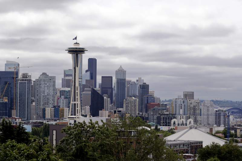 FILE - This July 23, 2020, file photo shows the view of the Space Needle, in Seattle. Record-high heat is forecast in the Pacific Northwest this weekend, raising concerns about wildfires and the health of people in a region where many don't have air conditioning. The National Weather Service has issued an Excessive Heat Watch and predicted dangerously hot conditions Friday, June 25, 2021, through at least Tuesday. (AP Photo/Elaine Thompson, File)