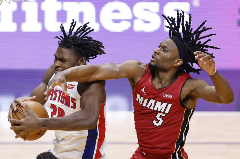 Isaiah Stewart of the Detroit Pistons and Precious Achiuwa of the Miami Heat battle for a rebound during the third quarter at American Airlines Arena on January 16, 2021 in Miami, Florida.