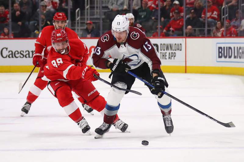 DETROIT, MICHIGAN - MARCH 02: Valeri Nichushkin #13 of the Colorado Avalanche tries to get around the stick of Sam Gagner #89 of the Detroit Red Wings during the first period at Little Caesars Arena on March 02, 2020 in Detroit, Michigan. (Photo by Gregory Shamus/Getty Images)