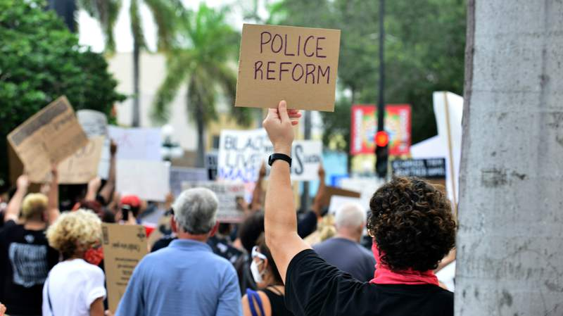 Protesters and clergyman demonstrate against police brutality and racism on June 7 in Hollywood, Florida. The recent death of George Floyd while in police custody in Minneapolis on May 25 ignited a global protest movement about racism and equality.