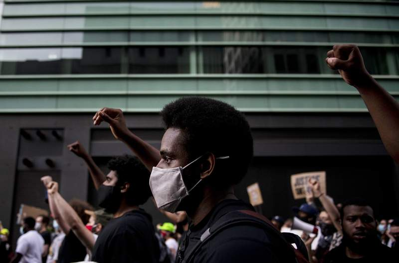 Protesters march in protest of the death of George Floyd, Saturday, June 6, 2020, in Detroit. The death of George Floyd at the hands of police last month in Minneapolis has sparked nationwide protests for police reform. (Nicole Hester/Mlive.com/Ann Arbor News via AP)