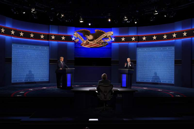 FILE - In this Sept. 29, 2020, file photo President Donald Trump, left, and Democratic presidential candidate former Vice President Joe Biden, right, participate in the first presidential debate with moderator Chris Wallace of Fox News, center, Case Western University and Cleveland Clinic, in Cleveland, Ohio. Even before Trump's hospitalization, Republicans were growing increasingly concerned about the direction of the election. Trump's allies were particularly worried that his troubling debate performance on Tuesday might further alienate key groups of swing voters: women and college-educated voters, among them.     (AP Photo/Patrick Semansky, File)